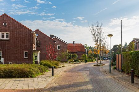 Neighborhood street view in Cuijk, the Netherlands on a sunny Autumn day