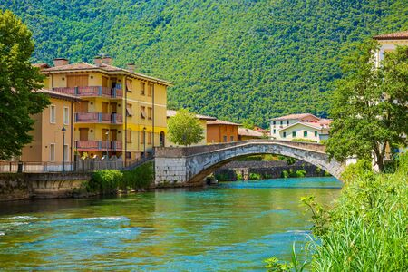 View on residential houses on the river Chiese at the village and commune Vobarno Brescia province, Lombardy, Italy,