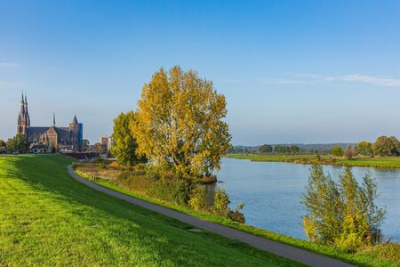 Land van Cuijk, agricultural landscape at the small village Cuijk and the Meuse river, the Netherlands under a blue sky. Popular touristic landmark for travel