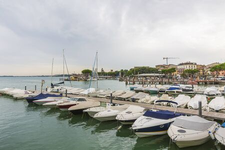 Desenzano del Garda, Brescia, Lombardy, Italy. Historic city touristic landmark, place for pleasure and interests. Фото со стока