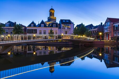 Traditional Dutch culture architecture houses and canal during the blue hour. Historical and touristic town Leiden, the Netherlands