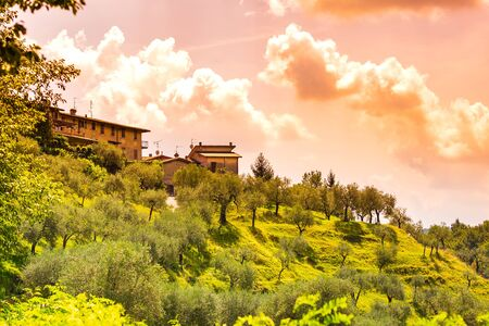 Rural landscape and a blue sunny sky at a old small village Renzano near Salo, Brescia region Lombardy Italy.