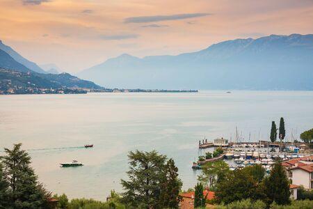 Portese, Italy, beautiful sunset above water at Lake Garda Banco de Imagens