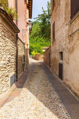 Old village street view at Renzano near Salo, Brescia region Lombardy Italy.. Narrow alley, old architexcture and touristic landmark Banco de Imagens