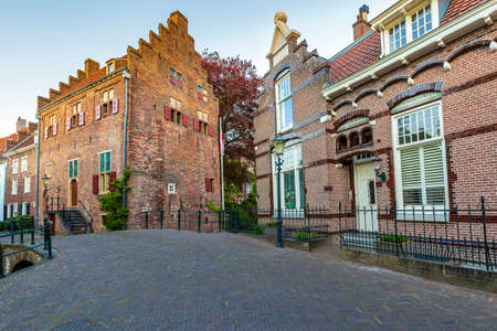 Best of Amersfoort; historic architecture on old street and bridge. Popular touristic landmark.