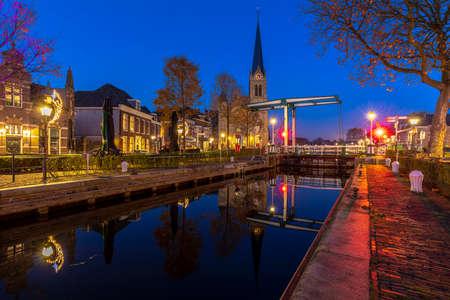 The historical village Leidschendam, located in the Netherlands at the Rijn-schiekanaal during dusk Stock Photo