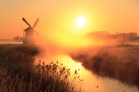 Sunrise at a Dutch windmill photo