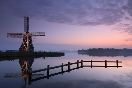 Tranquil sunset at Dutch windmill photo