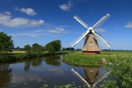 polder: Windmill in a polder in Holland Stock Photo