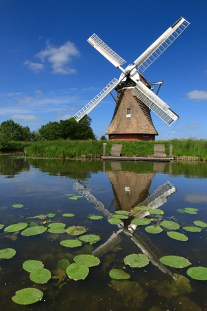 holland windmill: Windmill in a polder in Holland Stock Photo