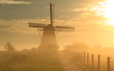 Windmill in the fog photo
