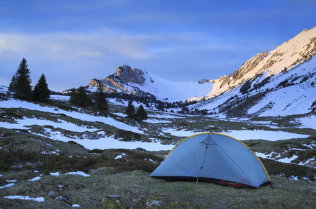 chartreuse: Tent at a campsite in the Chartreuse mountains, France, during a spring sunrise.