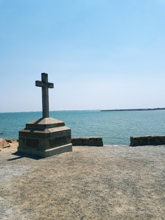 Stone cross in front of the crossing of Gois, Noirmoutier Island, France