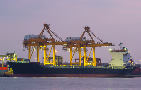 Cargo ship loading containers by crane , Trade Port , Shipping Stock Photo