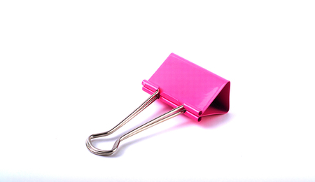 Pink Paper clip isolated on white background.