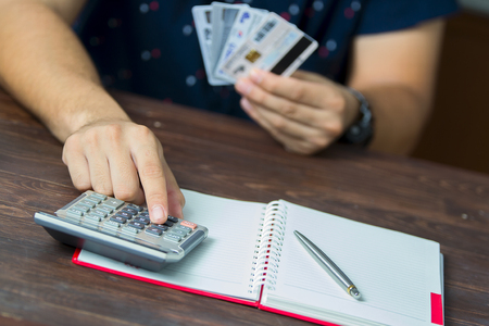 man calculate how much cost or spending have with credit cards Stock Photo