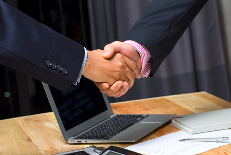 businessman handshake together on blue meeting room background in agreement,accept,approve financial cooperative goal,team international invest Stock Photo
