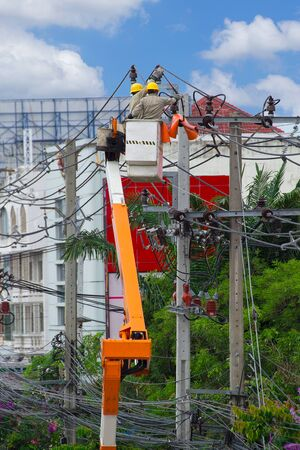 electrician overalls working at height and dangerous