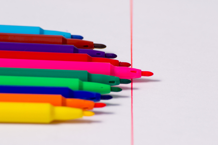 Business concepts: pink crayon standing out from the crowd