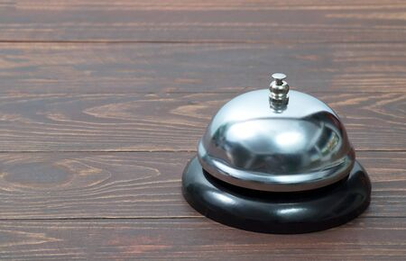 Service bell on the wooden table  Stock Photo