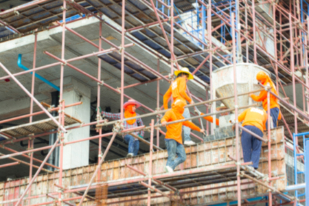 Construction, construction workers on site. blurred Background Stock Photo