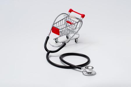 a shopping cart with a stethoscope inside, depicting the healthcare industry concept