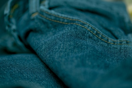 inner wear: Jeans made of thick blue cloth sewn with white thread