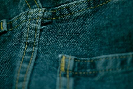 sewn: Jeans made of thick blue cloth sewn with white thread