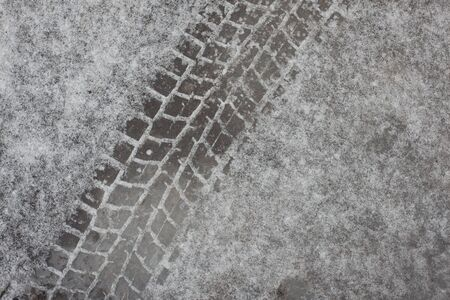 surround: crisp, surround the trail tread on the dirty spring snow Stock Photo