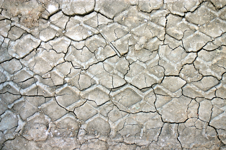 split level: gray, dried, cracked surface of the earth Stock Photo