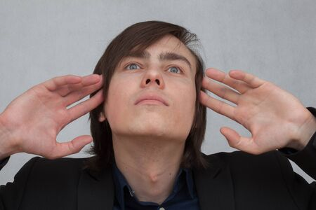 ocd: man trying to read the thoughts of others