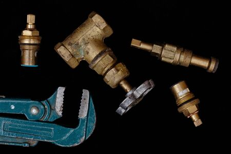 pipe wrench: faucets, valve, pipe wrench to repair the water supply system Stock Photo