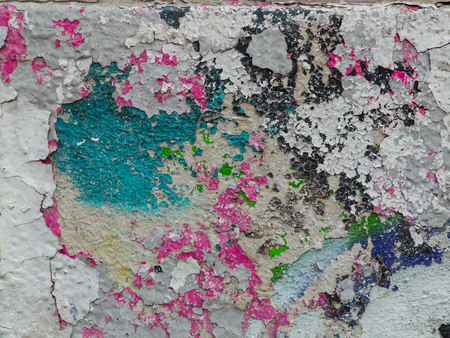 pink brown: green, pink, brown paint on the cracked plaster