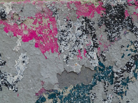 pink and brown: green, pink, brown paint on the cracked plaster