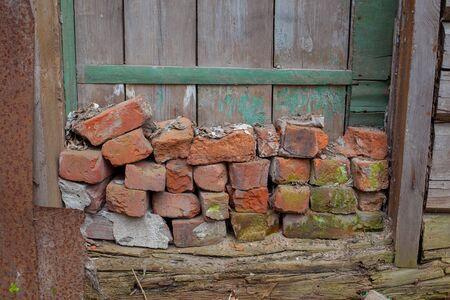 corroding: a pile of broken red bricks on the doorstep Stock Photo