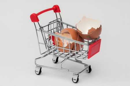 shell of a broken egg in a supermarket trolley Stock Photo
