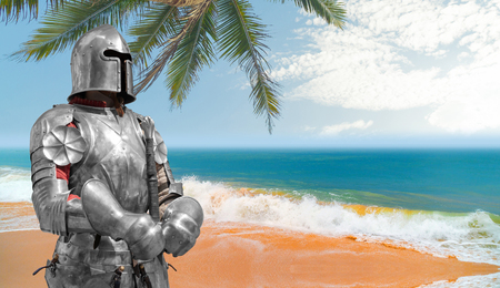 Knight in helmet and metal armor.