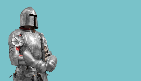 Medieval knight in shiny metal armor on a blue background.