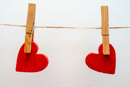 Two hearts on a clothesline.