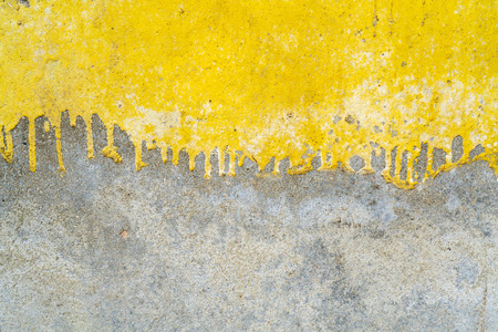 Texture of old plaster. Yellow and gray paint.