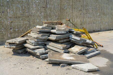 Underpass repair. Old broken tiles.