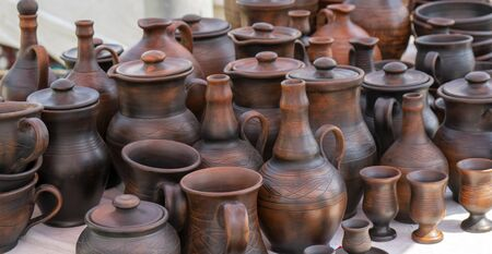 Handmade ceramic clay products. Jugs and glasses. Stock fotó