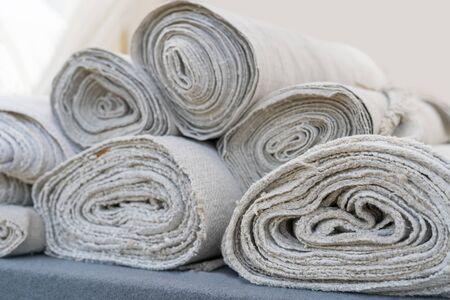Rolls of white linen fabric handmade.