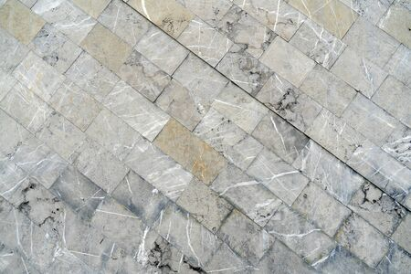 The texture of the gray tile is located diagonally.