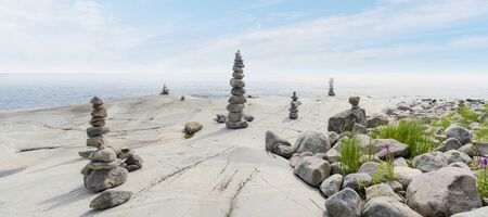 Stacked Rocks balancing, stacking with precision. Stone tower on the shore. Copy space.