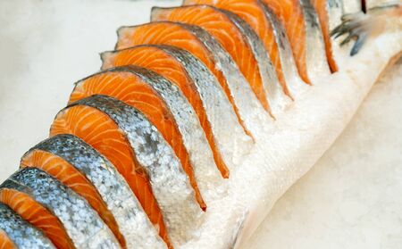 Steaks of fresh salmon. Sale on ice. Seafood shop. Фото со стока