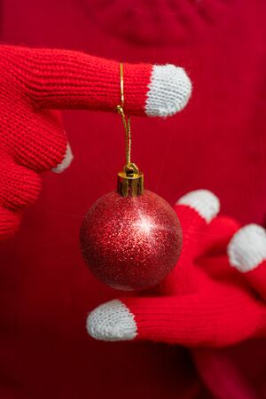Christmas decoration - shiny red ball. Festive composition.