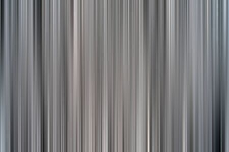 Abstract vertical pink lines background. Streaks are blurry in motion.