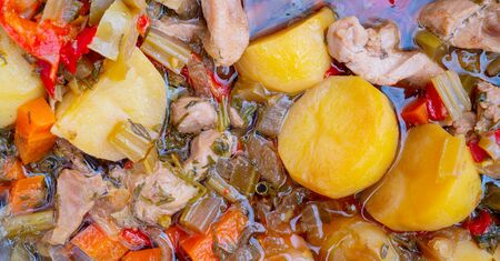 Canned stewed meat. Hot bowler. The texture of the food. Homemade food. Hot dish.