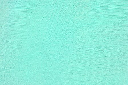 Texture of green stucco for modern interior. Abstract green background. 免版税图像